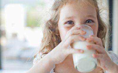 Girl drinking glass of milk
