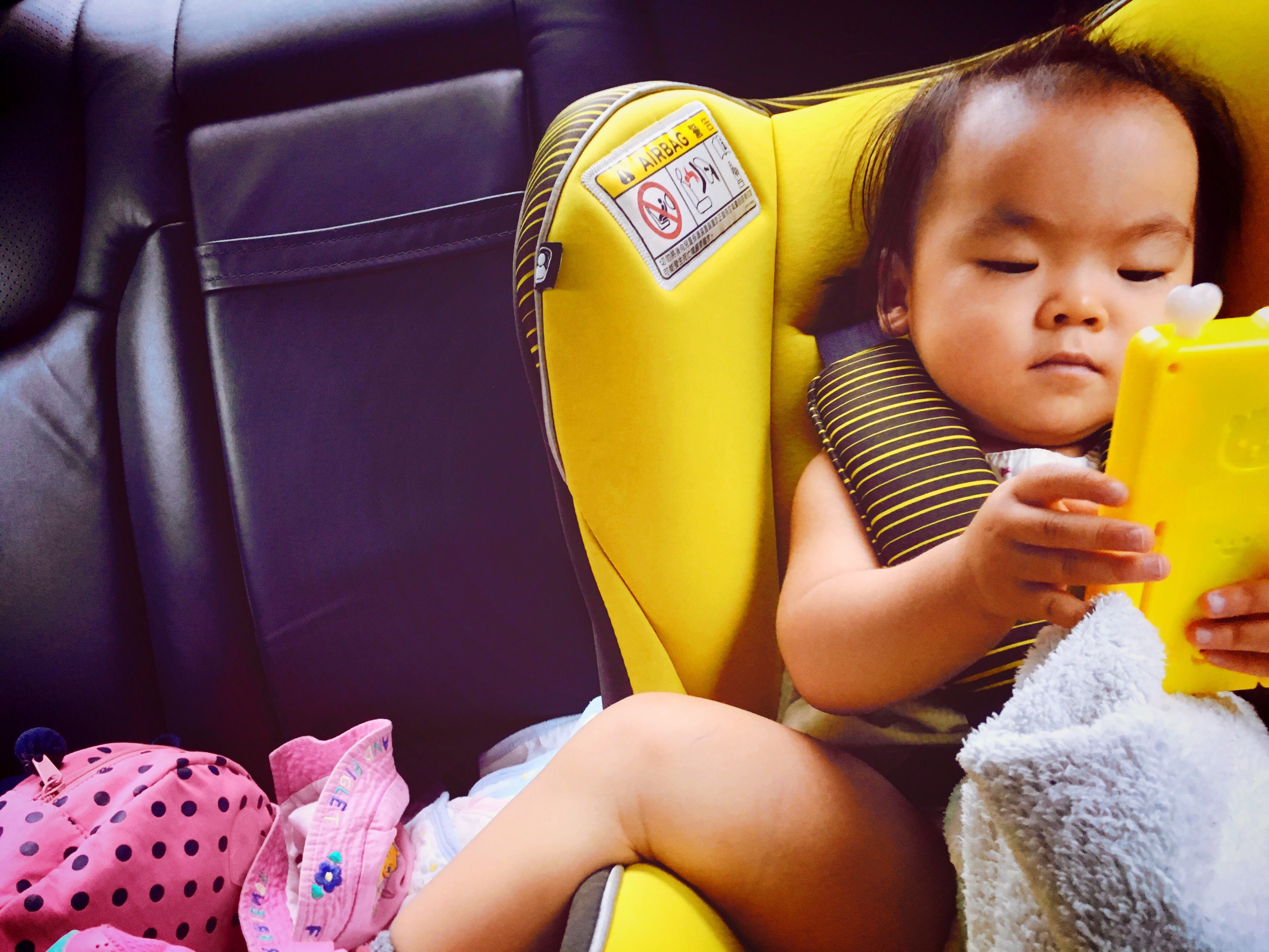 High Angle View Of Toddler Sitting In Car