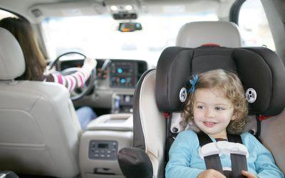 Toddler girl in rear-facing car seat