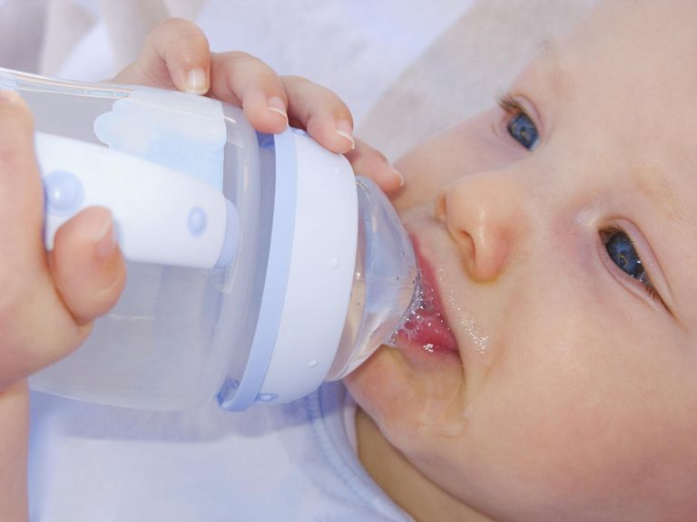 Baby drinking water from bottle