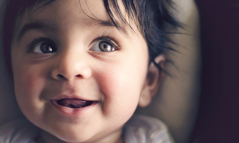 Indian baby smiling