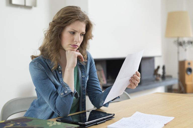 Woman looking over paperwork