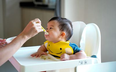 baby eating solid foods