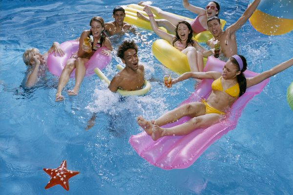 Teenagers playing in a swimming pool