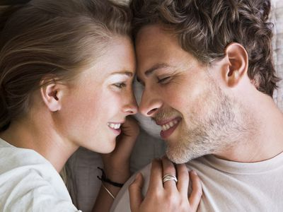 Couple in bed close up, feeling desire around ovulating time