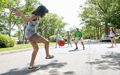 Girl playing kickball game