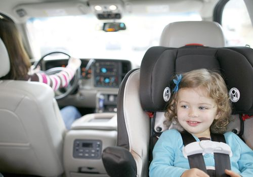 Toddler girl in rear-facing car seat