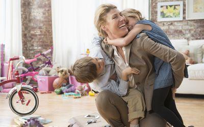 working mother greeting children