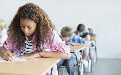 Students taking a test in classroom.