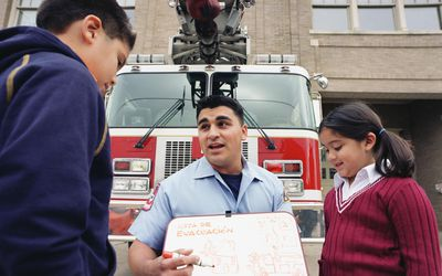 Fireman talking about evacuation routes to children