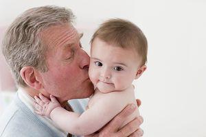 Grandfather kissing grandson