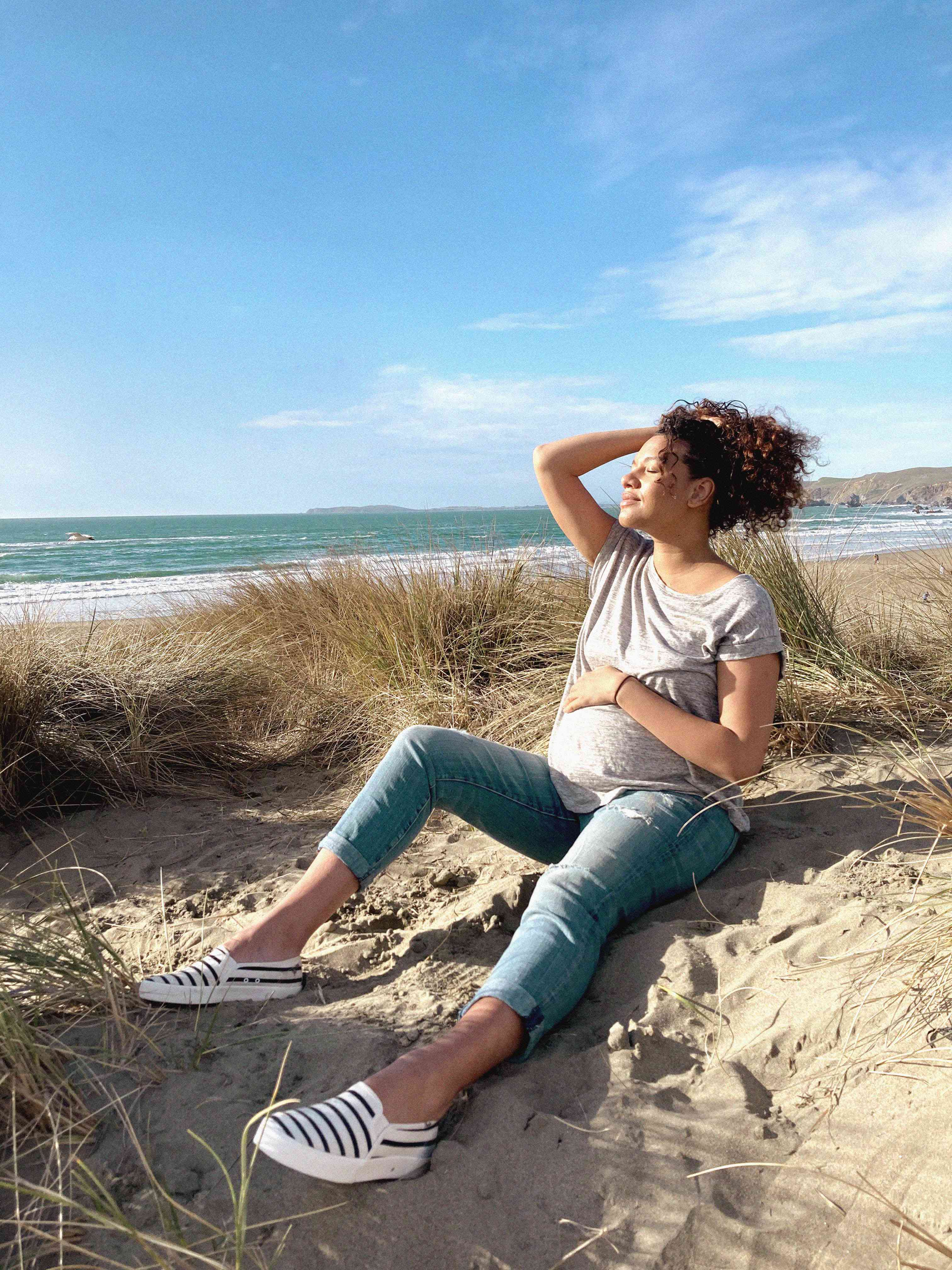 woman on the beach wearing Keds x HATCH shoes