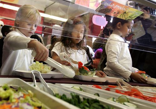 kids filling plates at salad bar