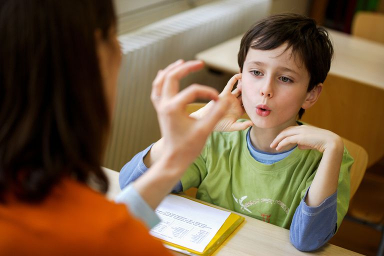 Boy working with a speech therapist