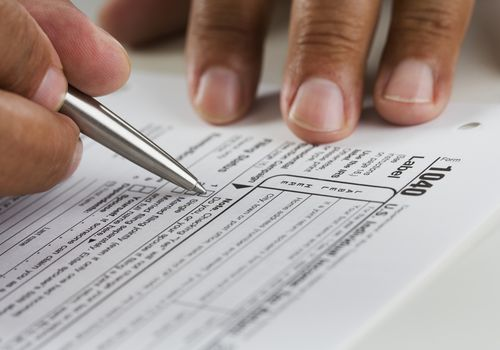 a closeup of a person doing their taxes
