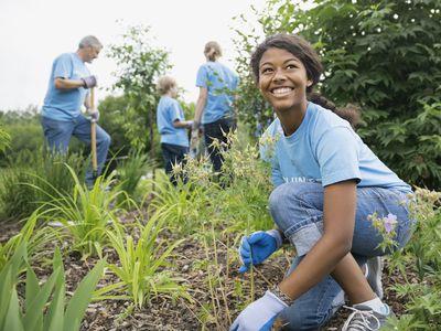 Smiling volunteer working in garden