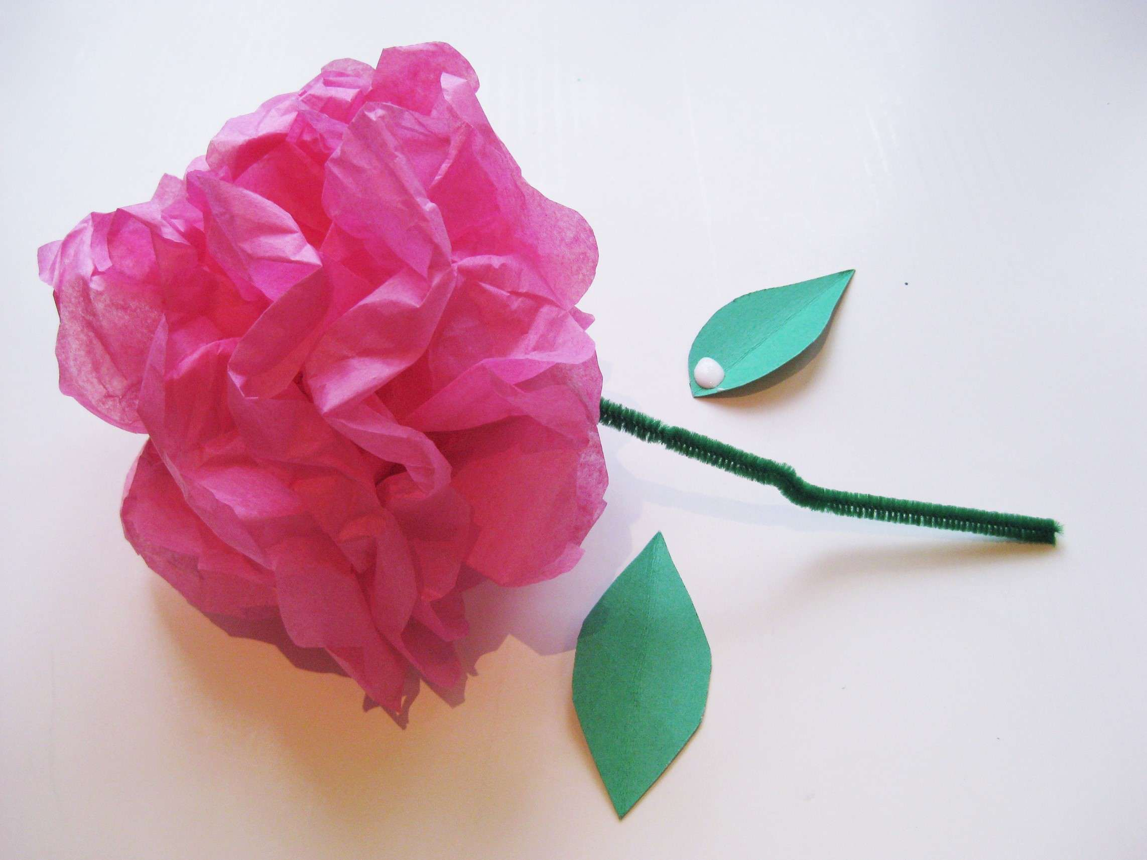 Simple steps to craft tissue paper flowers glue the leaves to the blossoms mightylinksfo