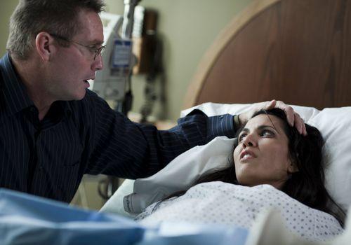 Man comforting woman giving birth
