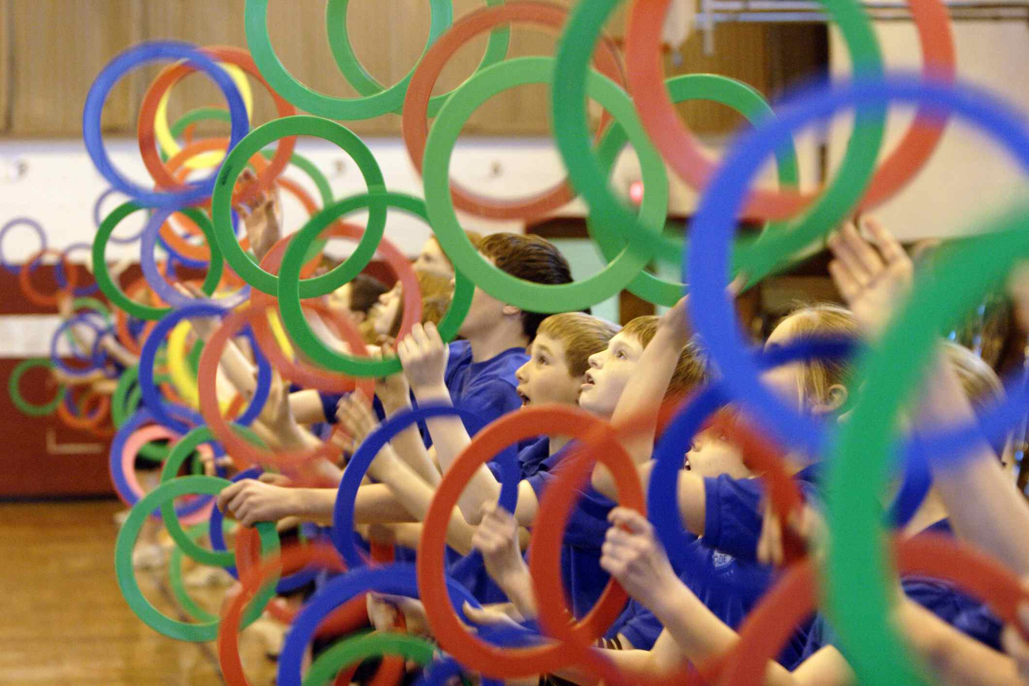 A group of children juggling with rings