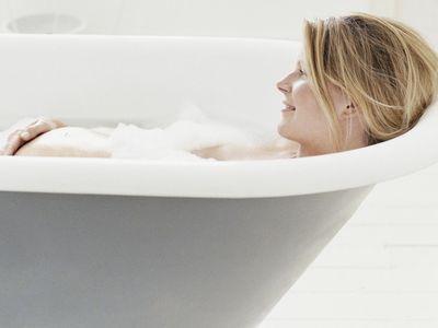 Pregnant Woman Lying in Bath.
