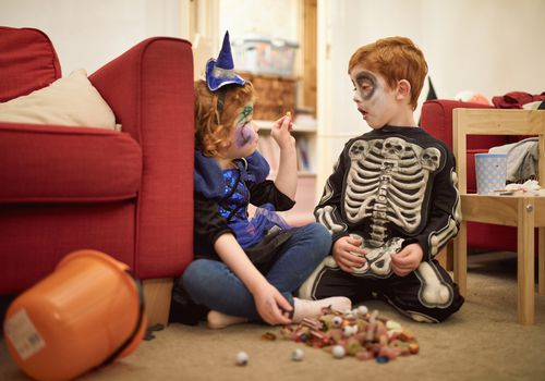 little kids eating candy after trick-or-treating