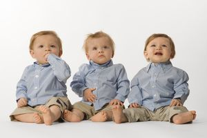 Tripets, three boys sitting on the floor, twins and triplets are a possible risk/side effect of fertility drugs