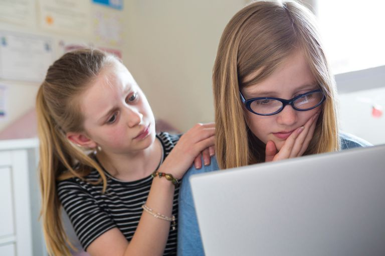 preteen girls dealing with cyberbullying