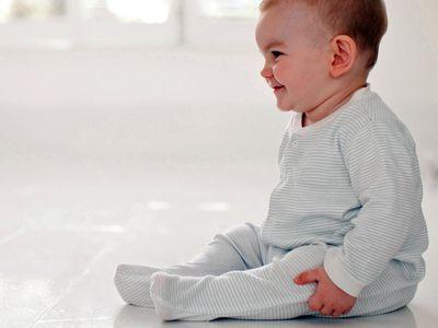 Baby sitting up on floor
