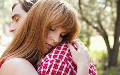 Young couple hugging close up