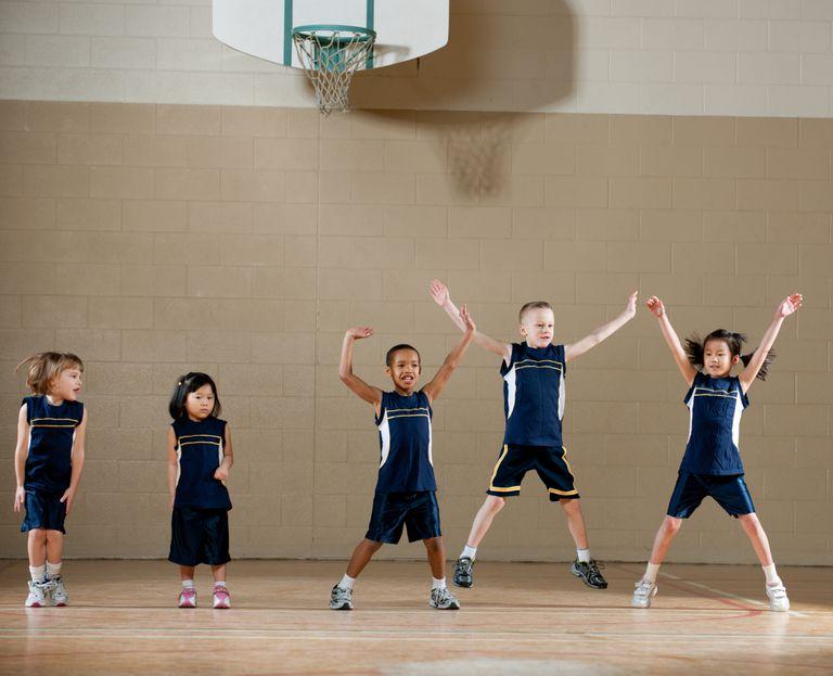 kids in gym jumping jacks