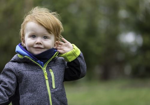 Toddler with red hair and green eyes