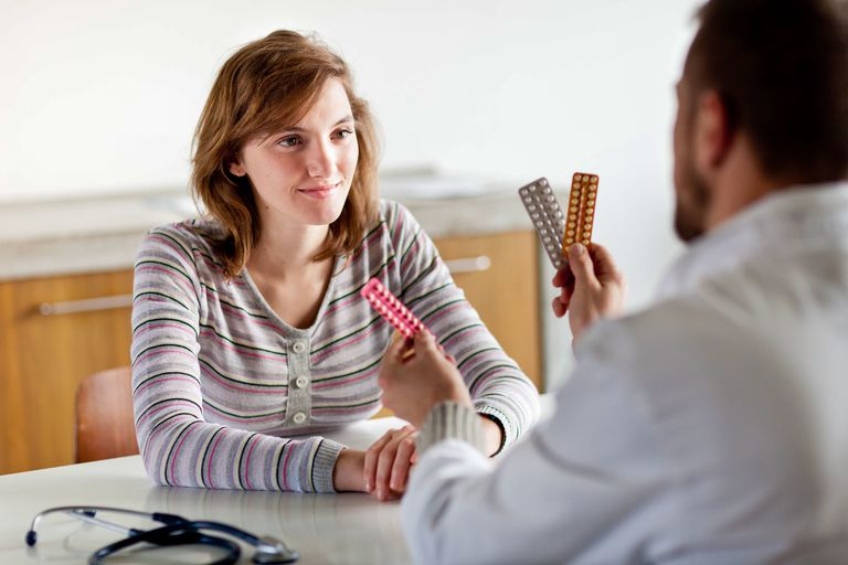 Teen talking to doctor about sexual health