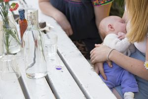 woman breastfeeding her baby at a cafe