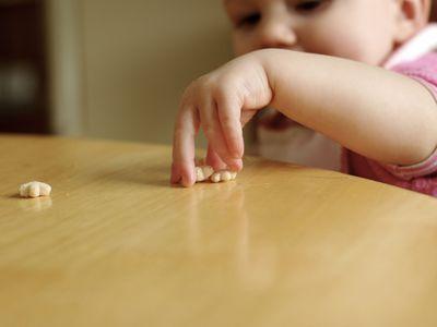 baby eating finger food