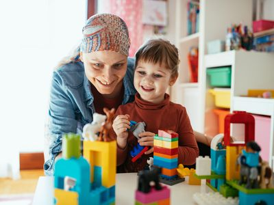 mom with cancer playing with daughter
