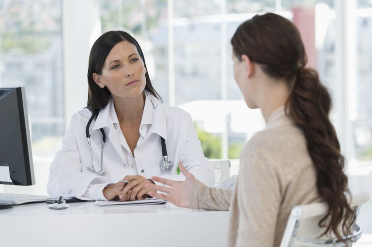 Female doctor talking with a patient