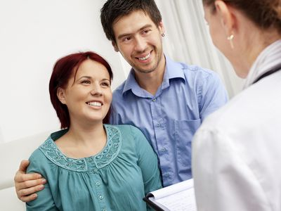 Gynecologist Talking to a couple who are preparing for an HSG exam