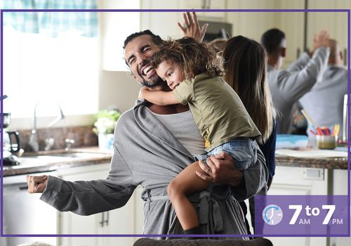 Justin Baldoni holding his child in the kitchen