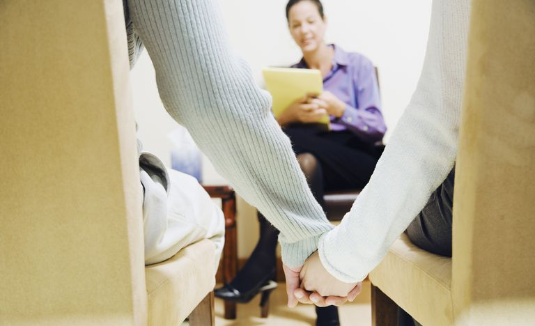 Couple Holding Hands With A Therapist