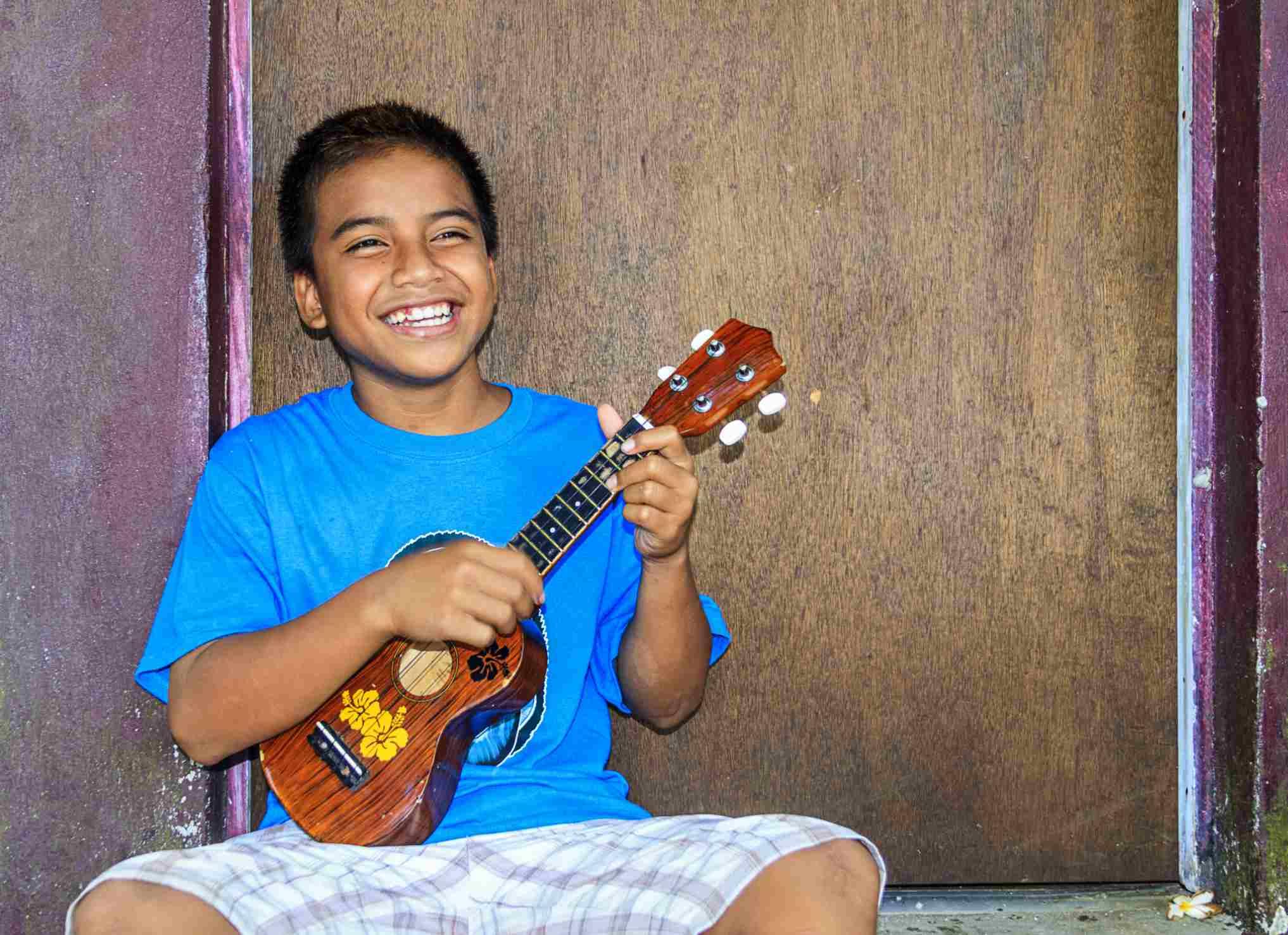 Boy playing a ukelele