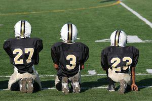 kids football - players on sidelines