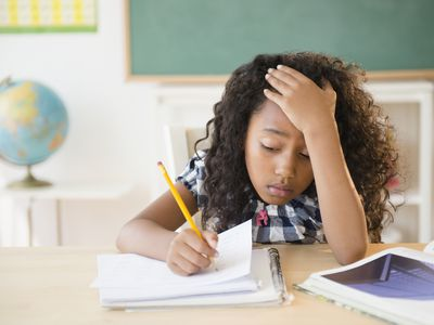 Frustrated young student working in classroom