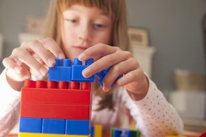 Child building with blocks