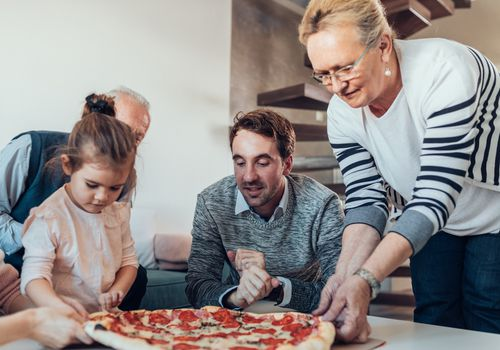 Shot of a happy family having pizza