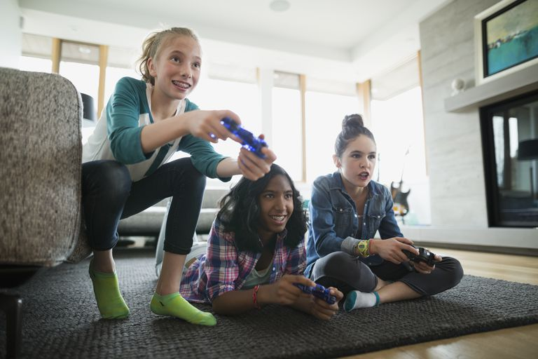 Girls playing video game living room rug