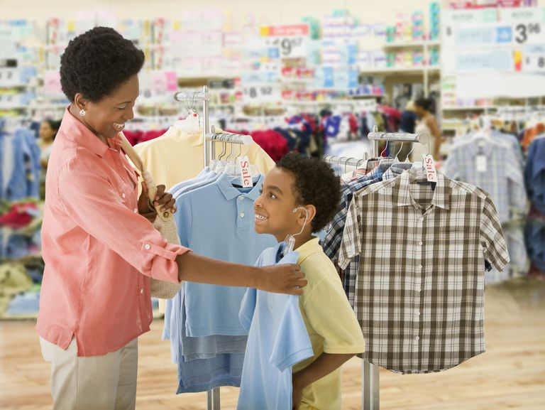 Mother and son shopping for shirts
