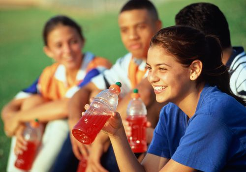 Teenagers with sports drinks