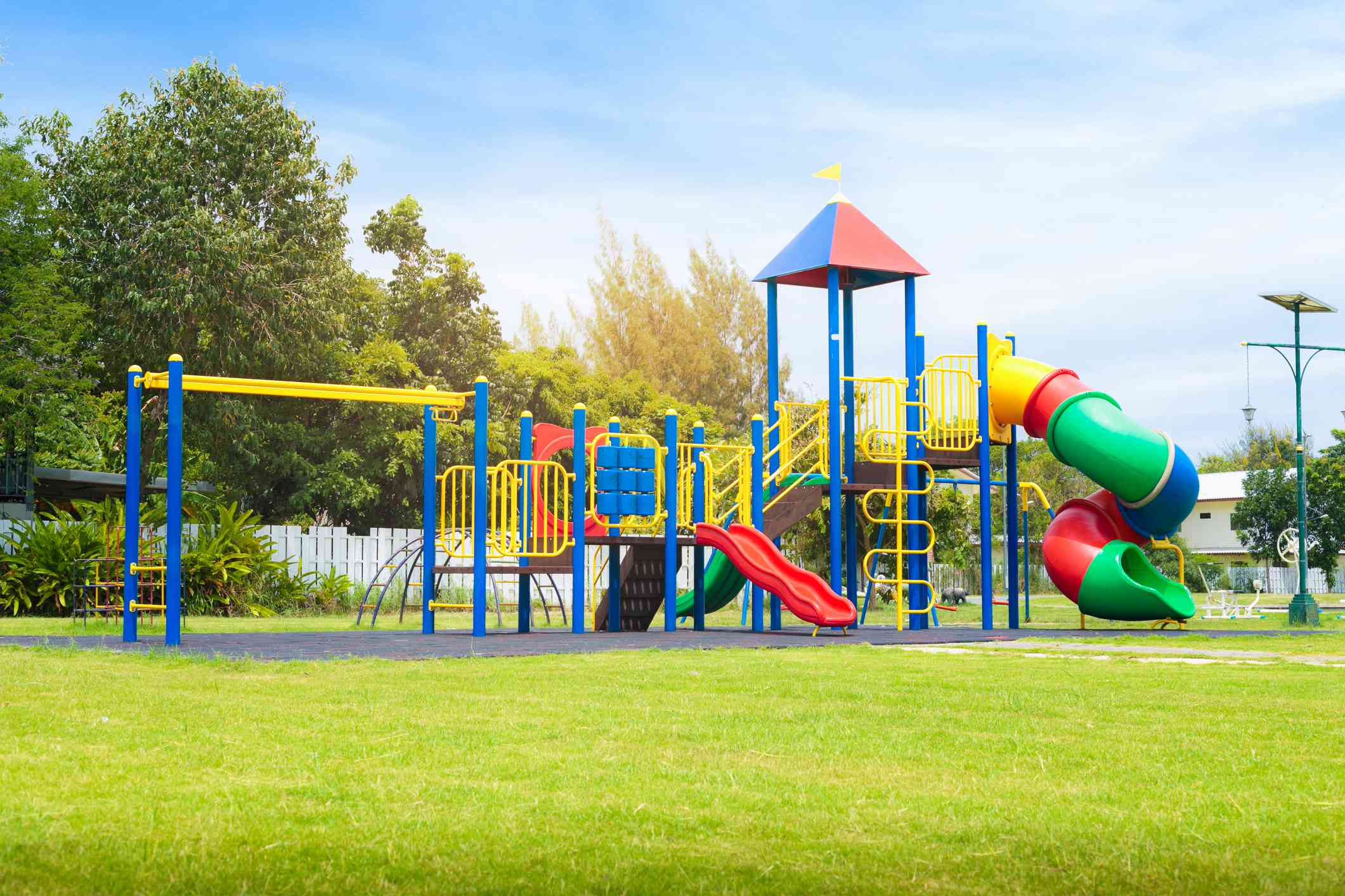 colorful playground equipment and grass