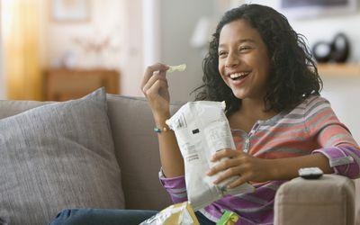 Tween girl eating chips