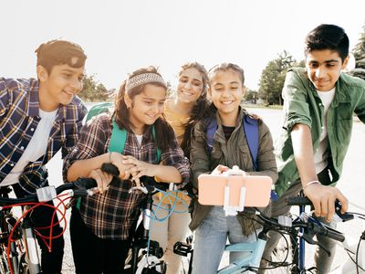 A group of middle school aged kids bike to school